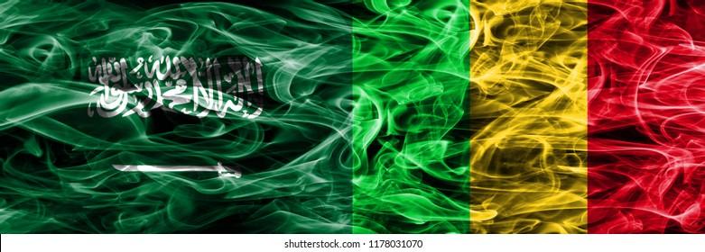 Saudi Arabia vs Mali smoke flags placed side by side. Thick colored silky smoke flags of Saudi Arabia and Mali