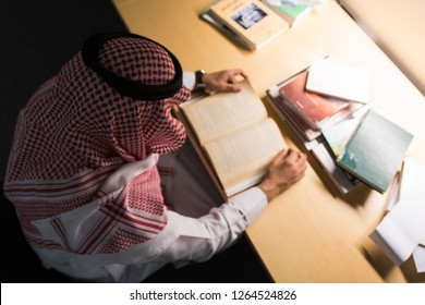 Saudi Arabian Man Reading a Book in The Library