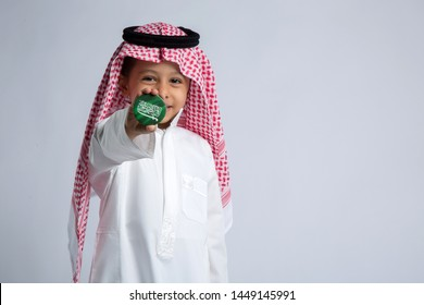 Saudi boy celebrating national day - Shutterstock ID 1449145991