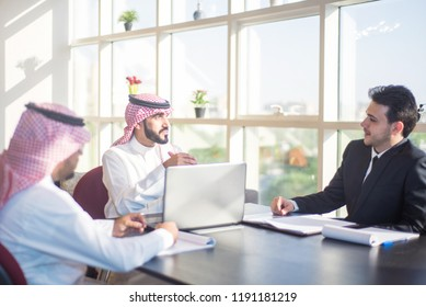 Saudi Business, Hands Signing a document, contract, Businessmen, Saudi Arabia Company, Meeting, Working on a Laptop, Gulf Work, Desk job, shemagh