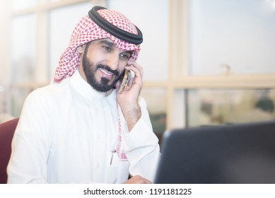 Saudi Business, Hands Signing a document, contract, Businessmen, Saudi Arabia Company, Meeting, Working on a Laptop, Gulf Work, Desk job, phone call