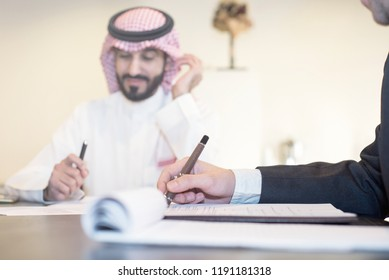 Saudi Business, Hands Signing a document, contract, Businessmen, Saudi Arabia Company, Meeting, Working on a Laptop, Gulf Work, Desk job
