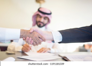 Saudi Business, Hands Signing a document, contract, Businessmen, Saudi Arabia Company, Meeting, Working on a Laptop, Gulf Work, Desk job, Hands shaking,