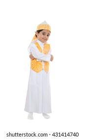 Saudi Kid In Traditional Saudi Uniform Posing on Isolated White Background.