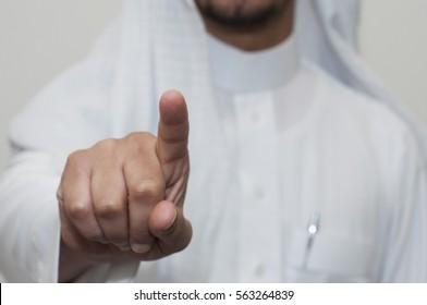 Saudi man indicates with his finger