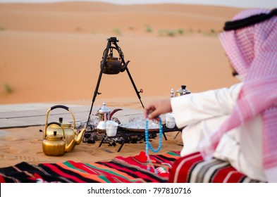 Saudi Man Sitting in Desert  (Bar)