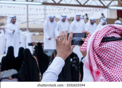 Saudi Man snaps Men perform a Yawalah traditional dance in Janadriyah Festival Essay February 23, 2018 in Riyadh, Saudi Arabia