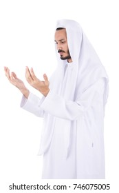 Saudi man worshipping his Almighty God. isolated on white background.