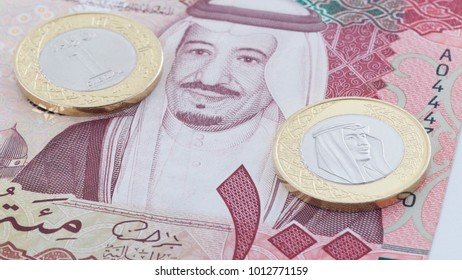 Saudi Riyal 100 Banknote and New Coin showing King Salman of Saudi Arabia