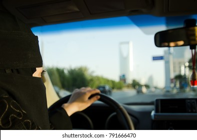 Saudi Woman Driving a Car in Saudi Arabia