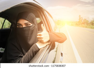 Saudi Woman Driving a Car on the road. Muslim Woman Driver concept
