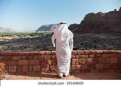 Saudian overlooking the old city of Al Ula, Saudi Arabia.