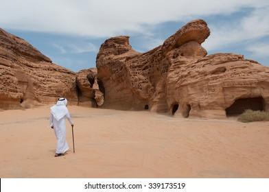 Saudian walking in Madain Saleh archeological site, Saudi Arabia.
