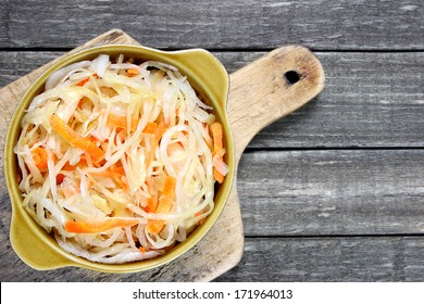 Sauerkraut with carrot in bowl