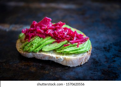 Sauerkraut on the top of avocado and sourdough bread