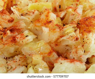 Sauerkraut salad with  red Cayenne pepper texture as a background.