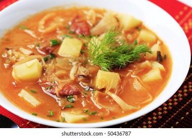 Sauerkraut soup with potatoes and sausage