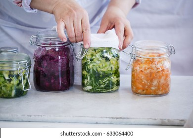 Sauerkraut variety preserving jars. Beetroot kraut, green kraut, yellow kraut in mason jars. Fermentation, probiotic, preserving  food concept