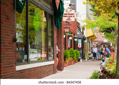 SAUGATUCK, MI - SEPT 4: Shops and galleries line Butler Street in Saugatuck, Michigan, on September 4, 2011. The many colorful venues are a major draw for thousands of visitors every year.