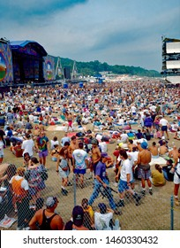 Saugerties, New York, USA, August, 1994 Massive crowds fill the muddy fields at the Winston Farm during Woodstock 94 a music festival to commemorate the 25th anniversary of the original Woodstock