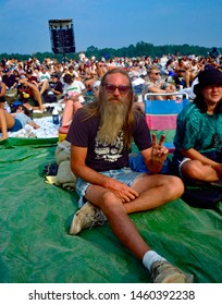 Saugerties, New York, USA, August, 1994 at the Winston Farm during Woodstock 94 a music festival to commemorate the 25th anniversary of the original Woodstock festival. Man flashing the peace sign.