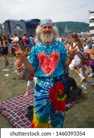 Saugerties, New York, USA, August, 1994 during Woodstock 94 a music festival to commemorate the 25th anniversary of the original Woodstock festival . Hippie flashing the peace sign