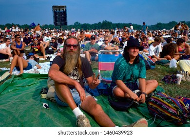 Saugerties, New York, USA, August, 1994 Man flashing the peace sign at Woodstock 94 a music festival to commemorate the 25th anniversary of the original Woodstock festival.