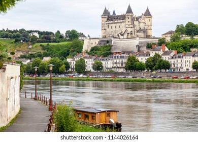 Saumur and its castle at the Loire river, France