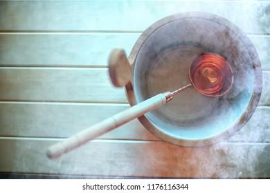 sauna accessories / spa concept, sauna relaxation, hot sauna accessories, steam, bucket, heat