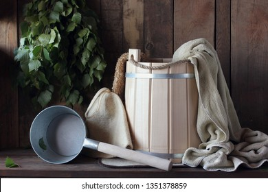 Sauna or bath, interior and accessories: bucket, towel, broom and hat for the bath.
