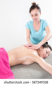 Sauna beauty relax a woman is relaxing during a massage given by a female