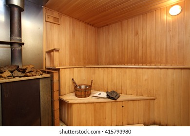 sauna with the furnace with wooden walls
