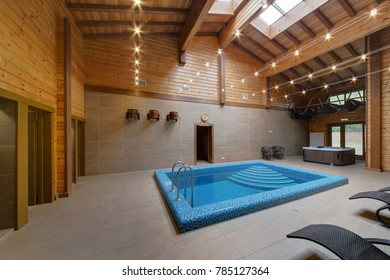 A sauna with the pool and exits in a bath and restrooms