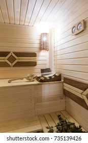 Sauna room with traditional sauna accessories close up