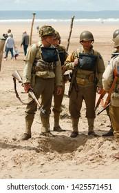 Saunton, Devon, UK - 15th June 2019: World War 2 reenactment (D-day)  weekend. Actors dressed in period Amercian infantry uniform