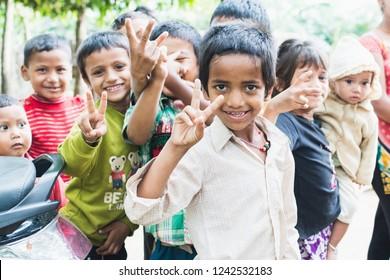 SAURAHA, NEPAL - APRIL 2015: portrait of Nepali children showing peace sign in Chitwan national park.