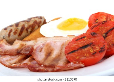 Sausage, bacon tomato and egg breakfast isolated on white, macro close up over white