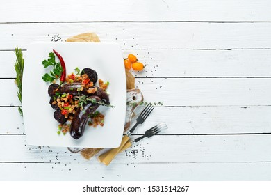 Sausage with buckwheat and blood. Restaurant dishes. Top view. Free copy space.