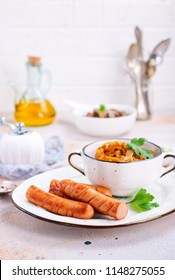 sausage with cabbage on the plate, fried sausages