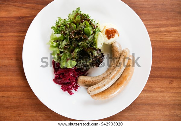 Sausage, Charcoal-boiled pork neck, pork steak with Mashed Potatoes and salad