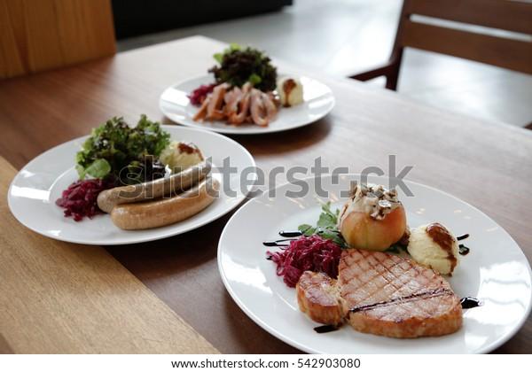Sausage, Charcoal-boiled pork neck, pork steak with Mashed Potatoes and salad