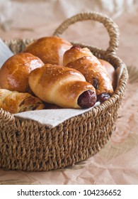 Sausage in dough for  breakfast in basket, selective focus