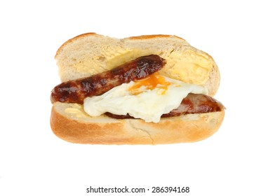 Sausage and fried egg in a buttered baguette isolated against white