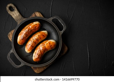sausage fried with herbs and spices. on the black board