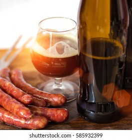 Sausage from the grill and a glass of beer.
