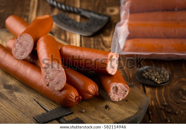 Sausage meat from the butcher. Wooden background with copy space.