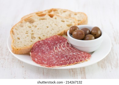 sausage with olive and bread