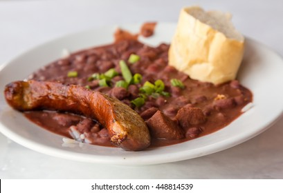Sausage on Read Beans and Rice with bread