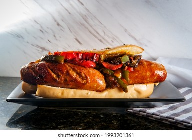 Sausage onions and peppers hoagie sandwich with tuxedo sesame seeds