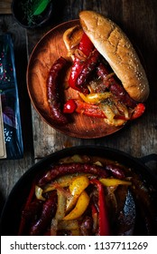 Sausage, Peppers, and Onions in iron pan.selective focus